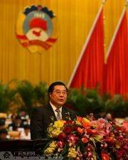 林国强作工作报告。